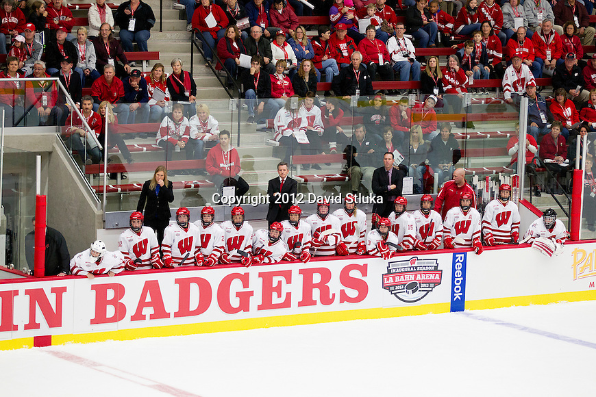 Wisconsin Badgers teammates look on from the bench during opening night against the Bemidji State Beavers at the LaBahn Arena Friday, October 19, 2012 in Madison, Wis. (Photo by David Stluka)