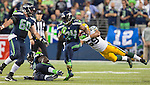 Seattle Seahawks running back Marshawn Lynch (24) breaks a tackle by Green Bay Packers linebacker Brad Jones during the fourth quarter of the NFL Kickoff held at CenturyLink Field September 4, 2014 in Seattle.  Lynch rushed for 110 yards and scored two touchdown in the Seahawks 36-16 win over the Packers.   Seattle beat Green Bay 36-16. ©2014  Jim Bryant Photo. ALL RIGHTS RESERVED.