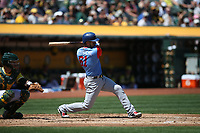 "OAKLAND, CA - AUGUST 26:  Robinson Chirinos #61 of the Texas Rangers bats against the Oakland Athletics during the game at the Oakland Coliseum on Saturday, August 26, 2017 in Oakland, California. Note: both teams are wearing special colorful uniforms for ""Players Weekend"" that also include nicknames on the backs of their jerseys. (Photo by Brad Mangin)"