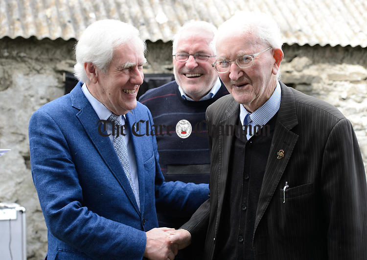 Br. Sean Mac Conmara, at right, with Labhrás Ó Murchú, Director-General of Comhaltas Ceoltóirí Éireann and Johnny Lyons at the unveiling of a memorial at the house where the blind piper Patrick O Brien was born at Labasheeda. Photograph by John Kelly.