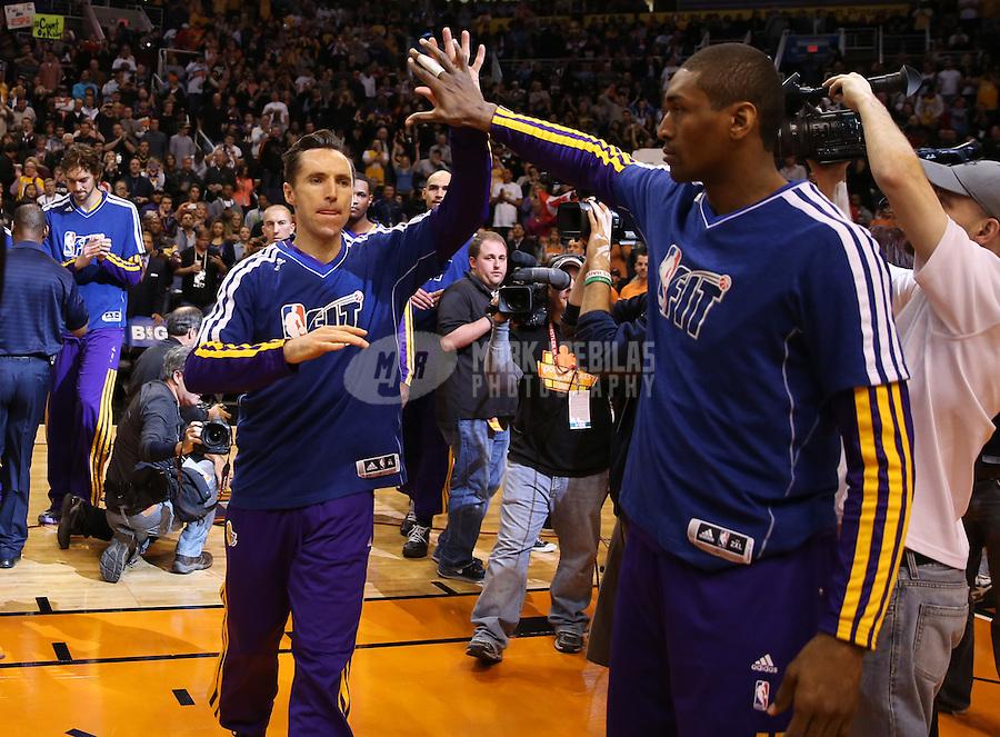 Jan. 30, 2013; Phoenix, AZ, USA: Los Angeles Lakers guard Steve Nash (left) greets forward Metta World Peace against the Phoenix Suns at the US Airways Center. Mandatory Credit: Mark J. Rebilas-