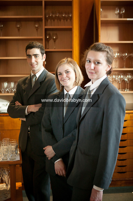 Waitressing students poses in uniform for the photographer at the Ecole Superieure de Cuisine Francaise Gregoire Ferrandi cooking school in Paris, France, 19 December 2007.