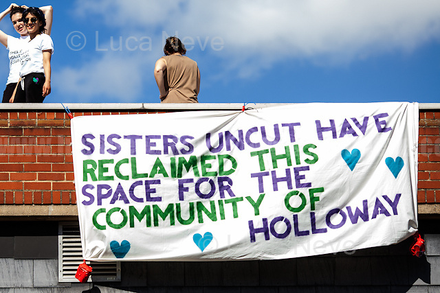 London, 27/05/2017. Today, feminist group &quot;Sister Uncut&quot; held a march from Camden Road Station to HM Prison Holloway (Largest women's prisons in Western Europe - https://en.wikipedia.org/wiki/HM_Prison_Holloway), where fellow protesters had already occupied the Visitors Centre (and its roof) of the adult women and young offenders' prison which was closed in July 2016 (with prisoners being moved to HMP Downview and HMP Bronzefield) and sold for housing. The aim of the demonstration was to protest against Theresa May's Government cuts to women's services and against the proposals for the former prison 10-acre site to be used as a &pound;2 billion housing development, including luxury flats. Heavy police presence cordoned the area of the visitors centre. From the organisers Facebook event page: &lt;&lt;On June 8, the UK could cement another 5 years of Tory rule. This would mean 5 more years living under a government whose extreme cuts, public service sell-offs and racist, sexist and disableist policies endanger the daily lives of women and non-binary people. Some examples of the attacks this Conservative government have subjected women and non-binary people to: At least 34 specialist domestic violence refuge services have closed since 2010, disproportionately affecting women of colour; 85% of the Tories austerity measures have fallen on women, most affecting disabled women, single parents and working class women of colour (The Womens Budget Group, 2016); In March of this year the government, following pressure from Women's Aid, pledged to make it easier for domestic violence survivors to vote anonymously and safely - but not in time for this election! [&hellip;]&gt;&gt;. I left the area of the protest around 20:30 and the occupation was still going on.<br />