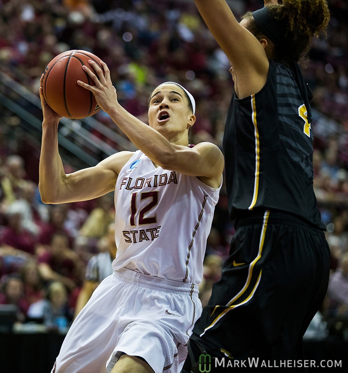 Florida State guard Brittany Brown drives past Missouri forward Cierra Porter during the second half of a second-round game of the NCAA women's college basketball tournament in Tallahassee, Fla., Sunday, March 19, 2017. Florida State defeated Missouri 77-55. (AP Photo/Mark Wallheiser)