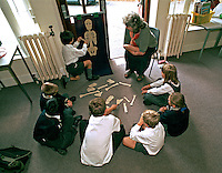 Schoolchildren taking part in a biology lesson with a science teacher. This image may only be used to portray the subject in a positive manner..©shoutpictures.com..john@shoutpictures.com