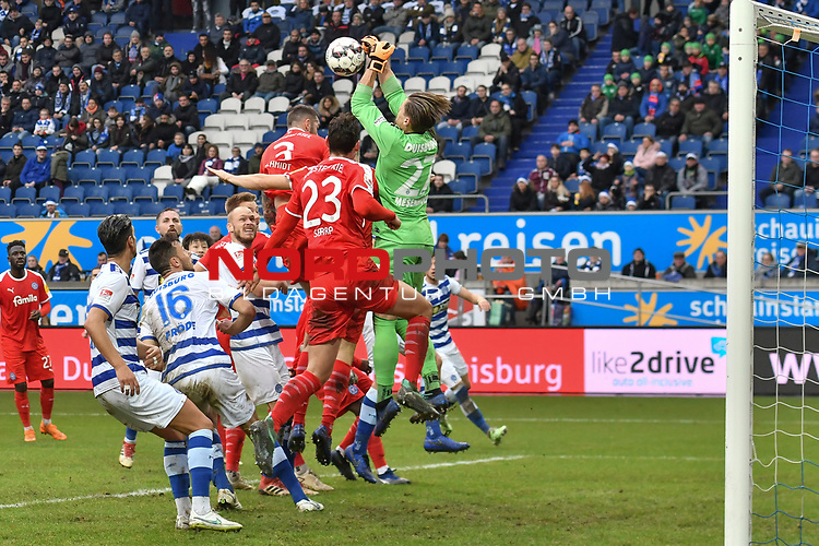 02.12.2018, Schauinsland-Reisen-Arena, Duisburg, GER, 2. FBL, MSV Duisburg vs. Holstein Kiel, DFL regulations prohibit any use of photographs as image sequences and/or quasi-video<br /> <br /> im Bild Daniel Mesenhöler / Mesenhoeler (#27, MSV Duisburg) pariert den Ball und verhindert Torchance von Dominik Schmidt (#3, Holstein Kiel) Janni-Luca Serra (#23, Holstein Kiel) <br /> <br /> Foto © nordphoto/Mauelshagen
