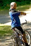 Man on bicycle listening to idpod.