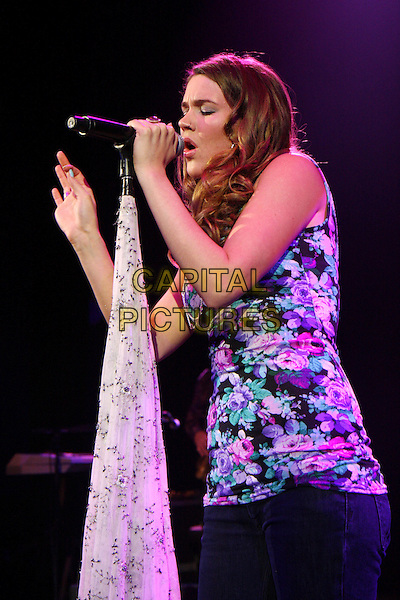 JOSS STONE.Performs live in concert at The O2 Shepherds Bush Empire, London, England, UK, March 11th 2010..Shepherd's music gig on stage half length microphone signing rose floral print top vest print pink purple side hand mouth open  profile green .CAP/MAR.©Martin Harris/Capital Pictures