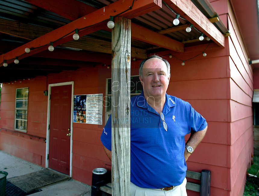 PGA Senior Tour player Allen Doyle stands at Doyle's Golf Center in LaGrange, Ga. on Wednesday, August 2, 2006. Doyle said he honed his swing at this driving range. He sold the business to a friend in 2003 after owning it for twenty years.