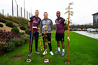 (L-R) Mike van der Hoorn, Lee Trundle and Leroy Fer of Swansea City plant poppy trees at The Fairwood Training Ground in Swansea, Wales. Wednesday 07 November 2018