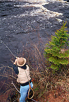 A MAN FLY FISHES ON THE EAST BRANCH OF THE ESCANABA RIVER NEAR GWINN MICHIGAN.
