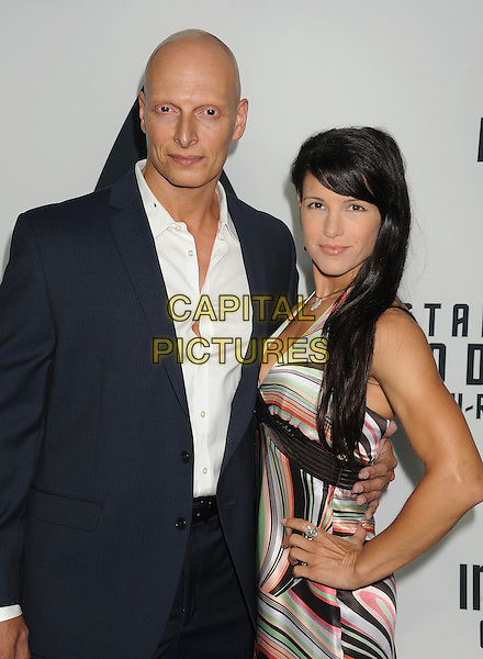 Joseph Gatt, Mercy Malick<br /> &quot;Star Trek Into Darkness&quot; DVD/Blu-Ray Release held at the California Science Center, Los Angeles, California, USA.<br /> September 10th, 2013<br /> half length suit white shirt print dress<br /> CAP/ROT/TM<br /> &copy;Tony Michaels/Roth Stock/Capital Pictures