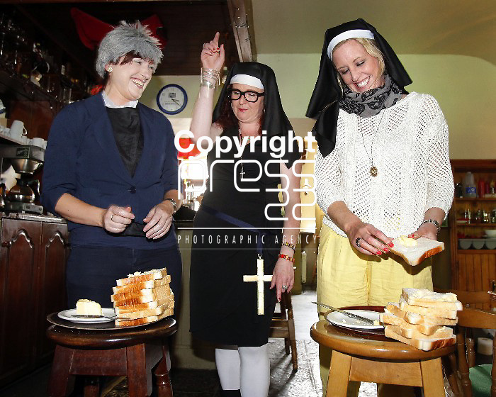 30/06/12 Sr Attracta Savage, Ted Tours (Centre) oversees a bread buttering competition between Eimer Loakman and Clodagh Dunleavy at Ted Festival which took place in Kilfenora, Co. Clare over the weekend. Picture: Don Moloney / Press 22