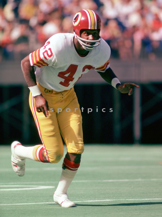 Washington Redskins Charley Taylor (42) during a game from his 1974 season with the Washington Redskins. Charley Taylor played for 13 seasons, all with the Washington Redskins, was a 8-time Pro Bowler and was inducted into the Pro Football Hall of Fame in 1984.(SportPics)