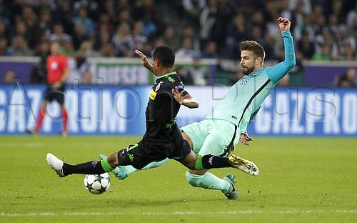 28.09.2016. Moenchengladbach, Germany. UEFA Champions league football. Borussia Moenchengladbach versus FC Barcelona.  Gerard Pique FC Barcelona challenges Raffael (Bor. Moenchengladbach)