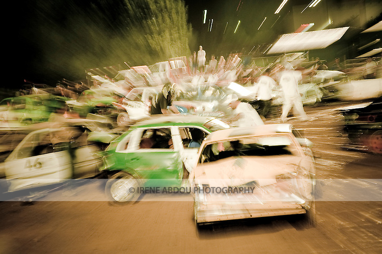 An in-camera zoom blur of this demoliton derby at the 2007 Montgomery County Agricultural Fair was created by zooming the camera lens while pressing the shutter button.  A slower shutter speed is required to capture the zoom effect.  In this image, a shutter speed of 1/2 second was used.