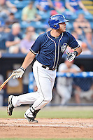 Asheville Tourists first baseman Roberto Ramos (27) swings at a pitch during a game against the Rome Braves on July 25, 2015 in Asheville, North Carolina. The Braves defeated the Tourists 3-2. (Tony Farlow/Four Seam Images)