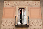 A painted building with a balcony in the old town of Locarno, Switzerland