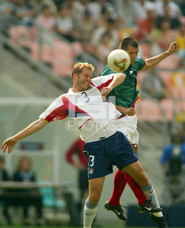 Gregg Berhalter battles Jared Borgetti for a header. The USA defeated Mexico 2-0 in the Round of 16 of the FIFA World Cup 2002 in South Korea on June 17, 2002.
