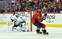 WASHINGTON, DC - FEBRUARY 05: Washington Capitals left wing Alex Ovechkin (8) turns in the offensive zone while Vancouver Canucks goalie Jacob Markstrom (25) watches the puck during the Vancouver Canucks vs. the Washington Capitals NHL game at Capital One Arena in Washington, D.C.. (Photo by Randy Litzinger/Icon Sportswire)