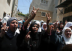 Palestinian women mourn the body of Ibrahim Sarhan, killed by Israeli military, during his funeral in the West Bank refugee camp of El Fara, north of Nablus, Wednesday, July 13, 2011. Sarhan was killed Wednesday in an Israeli military raid on a West Bank refugee camp, Palestinians said, when Israeli troops had entered the El Fara camp in pursuit of a fugitive militant. According to witnesses residents began throwing stones at the troops, who responded with live fire, killing Sarhan. Photo by Issam Rimawi