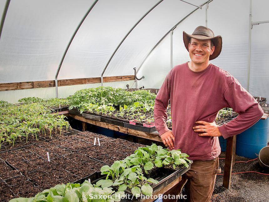 Paul Kaiser in spring greenhouse with organic vegetable starts at Singing Frogs Farm;