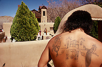 Gary Duran, a lifelong Chimayó resident, had the image of the Santuario tattooed on his back to show pride in his home. The church, built in 1813 by a member of the Penitente brotherhood, is an icon of local culture.