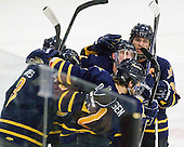 The Bobcats celebrate John Dunbar's (Quinnipiac - 24) third period goal  which completed scoring in the game. - The visiting Quinnipiac University Bobcats defeated the Harvard University Crimson 3-1 on Wednesday, December 8, 2010, at Bright Hockey Center in Cambridge, Massachusetts.