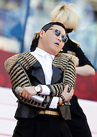 Calcio, finale di Coppa Italia: Roma vs Lazio. Roma, stadio Olimpico, 26 maggio 2013..Korean singer Psy performs prior to the start of the Italian Cup football final match between AS Roma and Lazio at Rome's Olympic stadium, 26 May 2013..UPDATE IMAGES PRESS/Isabella Bonotto....