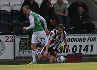 Leigh Griffiths fouls Paul McGowan in the St Mirren v Hibernian Clydesdale Bank Scottish Premier League match played at St Mirren Park, Paisley on 29.4.12.