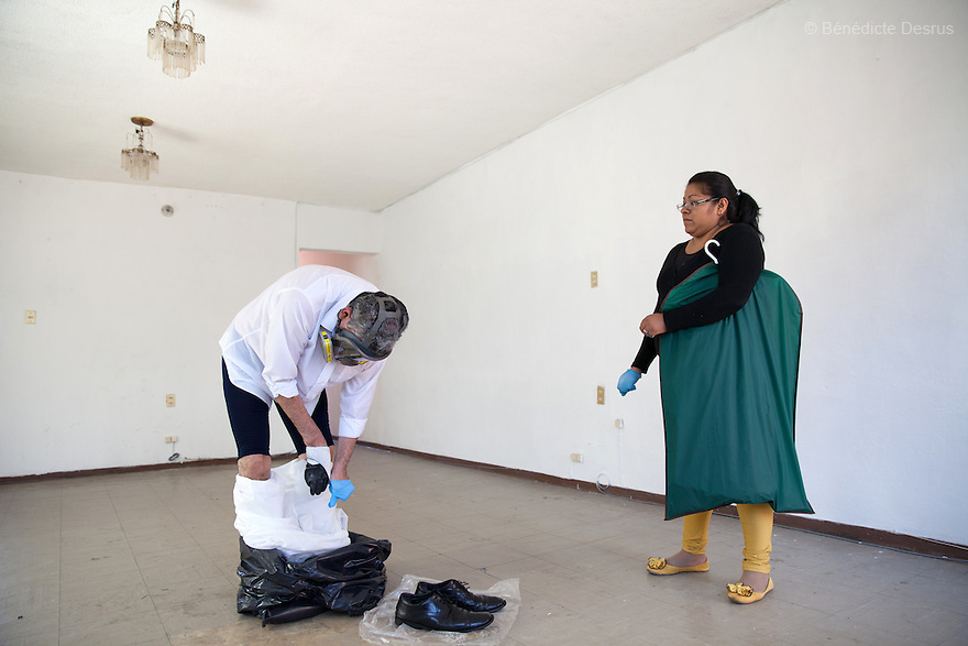 "Donovan removes his Hazmat suit and changes clothes after carrying out the forensic cleaning of the scene of an unsolved homicide in Cuernavaca, Morelos – one of Mexico's most dangerous cities on August 7, 2015. The 66-year-old victim was a retired economics lecturer from the local university, and was killed in January of this year. The cleanup took place eight months later. The victim's family has since moved away to avoid further trouble. They remarked that justice is slow in Mexico and expressed dissatisfaction with the police investigation, but appreciated Donovan's discretion and professionalism. Donovan Tavera, 43, is the director of ""Limpieza Forense México"", the country's first and so far the only government-accredited forensic cleaning company. Since 2000, Tavera, a self-taught forensic technician, and his family have offered services to clean up homicides, unattended death, suicides, the homes of compulsive hoarders and houses destroyed by fire or flooding. Despite rising violence that has left 70,000 people dead and 23,000 disappeared since 2006, Mexico has only one certified forensic cleaner. As a consequence, the biological hazards associated with crime scenes are going unchecked all around the country. Photo by Bénédicte Desrus"