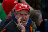 """A supporter yells, """"fake news"""" at the media during a Make America Great Again campaign rally at Atlantic Aviation in Moon Township, Pennsylvania on March 10th, 2018. Credit: Alex Edelman / CNP"""