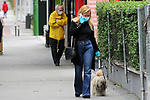 A woman walks her dog down a street in Madrid during the health crisis due to the Covid-19 virus pandemic - Coronaviruss. April 30,2020. (ALTERPHOTOS/Alejandro de Dios)