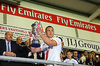 PICTURE BY ALEX WHITEHEAD/SWPIX.COM - Rugby League - International Origin Match - England vs Exiles - The Halliwell Jones Stadium, Warrington, England - 14/06/13 - England captain, Kevin Sinfield lifts the trophy following the win.