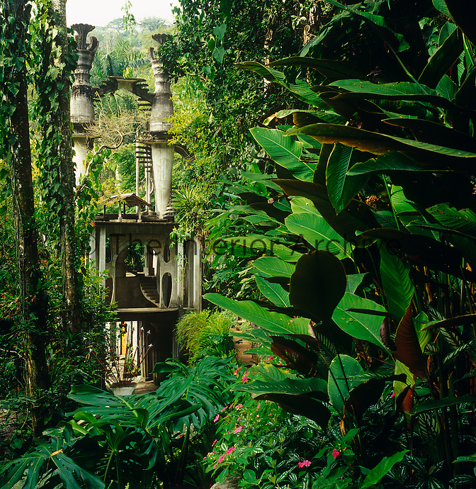 Rising above the overgrown garden is one of a series of follies created by the visionary Edward James
