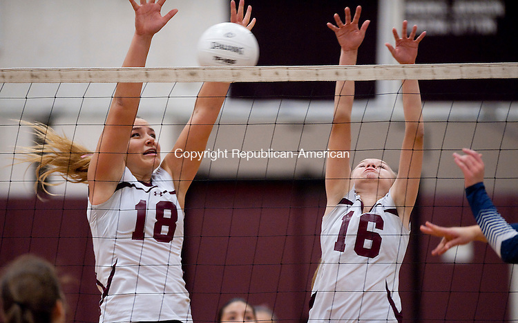 TORRINGTON, CT--- -111215JS11--Torrington's Caitlyn Cornish (18) and Lauren Gaghan (16) try to block a shot during their second round Class L tournament game against Avon Thursday at Torrington High School.<br /> Jim Shannon Republican-American