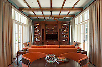 The Club Room is warm with orange and turquoise tones creating a cozy TV<br />