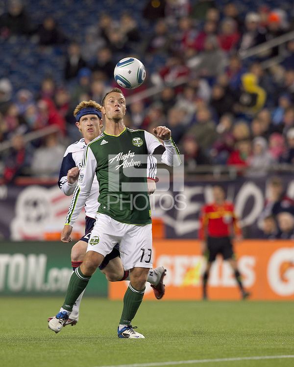 Portland Timbers midfielder Jack Jewsbury (13) controls the ball as New England Revolution midfielder Pat Phelan (28) pressures. In a Major League Soccer (MLS) match, the New England Revolution tied the Portland Timbers, 1-1, at Gillette Stadium on April 2, 2011.