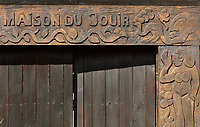 Carved wooden lintel on the reconstruction of the Maison du Jouir or House of Pleasure, home to French artist Paul Gauguin, 1848-1903, from 1901 to his death, now part of the Paul Gauguin Cultural Center, a museum which opened in 2003, in Atuona, on the island of Hiva Oa, in the Marquesas Islands, French Polynesia. The building is a traditional 2-storey hut with a wooden lintel carved by Gauguin in 1901 with the inscription, 'Be mysterious. Be loving and you will be happy'. Picture by Manuel Cohen
