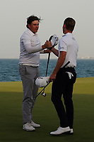 Brandon Stone (RSA) congratulates Sami Valimaki (FIN) on winning the Oman Open 2020 at the Al Mouj Golf Club, Muscat, Oman . 01/03/2020<br /> Picture: Golffile | Thos Caffrey<br /> <br /> <br /> All photo usage must carry mandatory copyright credit (© Golffile | Thos Caffrey)
