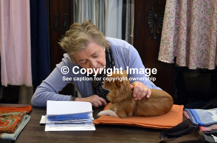 This Bellagio, Italy, clothes shop proprietor seemed more interested in her chihuahua dog than making a sale.  291410043687<br /> <br /> Copyright Image from Victor Patterson, 54 Dorchester Park, Belfast, UK, BT9 6RJ<br /> <br /> t: +44 28 9066 1296<br /> m: +44 7802 353836<br /> vm +44 20 8816 7153<br /> <br /> e1: victorpatterson@me.com<br /> e2: victorpatterson@gmail.com<br /> <br /> www.victorpatterson.com<br /> <br /> IMPORTANT: Please see my Terms and Conditions of Use at www.victorpatterson.com