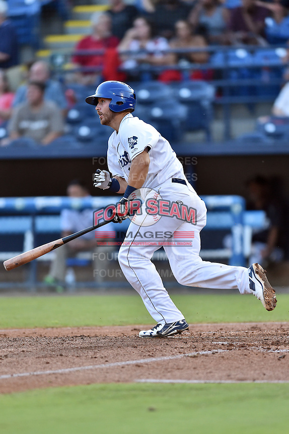 Asheville Tourists first baseman Brian Mundell (15) swings at a pitch during a game against the Augusta GreenJackets at McCormick Field on August 5, 2016 in Asheville, North Carolina. The Tourists defeated the GreenJackets 7-6. (Tony Farlow/Four Seam Images)
