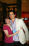 """Guiding Light's Matt Bomer """"Ben Reade"""" and now """"Neal Caffrey on USA's White Collar poses with fan Donna was a part of White Collar Comes Clean at the Paley Center for Media, New York City, NY on June 7, 2010. (Photo by Sue Coflikn/Max Photos)"""