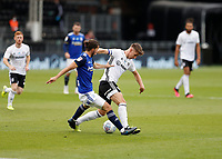 4th July 2020; Craven Cottage, London, England; English Championship Football, Fulham versus Birmingham City; Tom Cairney of Fulham challenged by Ivan Sunjic of Birmingham City