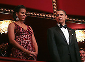 United States President Barack Obama and First Lady Michelle Obama attend the 2010 Kennedy Center Honors Ceremony in Washington, D.C. on December 5, 2010.  The recipients for the 33rd annual awards are singer and songwriter Merle Haggard; composer and lyricist Jerry Herman; dancer, choreographer and director Bill T. Jones; songwriter and musician Paul McCartney; and producer, television host and actress Oprah Winfrey. .Credit: Gary Fabiano / Pool via CNP