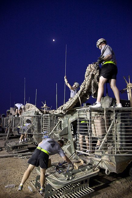 KUWAIT - CAMP VIRGINIA  19 AUGUST 2010: Soldiers of the 4/2 Strykers Brigade begin to break down their vehicles in preparation for the journey home after arriving during the previous night as the last combat units to leave Iraq.  Iraq is preparing after US President Barack Obama has confirmed the end of all combat operations in the country by 31 August..Some 50,000 of 65,000 US troops currently in Iraq are set to remain until the end of 2011 to advise Iraqi forces and protect US interests.The remaining 50,000 troops will stay in the country in order to train Iraqi security forces, conduct counterterrorism operations and provide civilians with ongoing security, said Mr Obama..An agreement negotiated with the Iraqis in 2008 states that these troops must be gone from the country by the end of next year. pic Graham Crouch/The Guardian