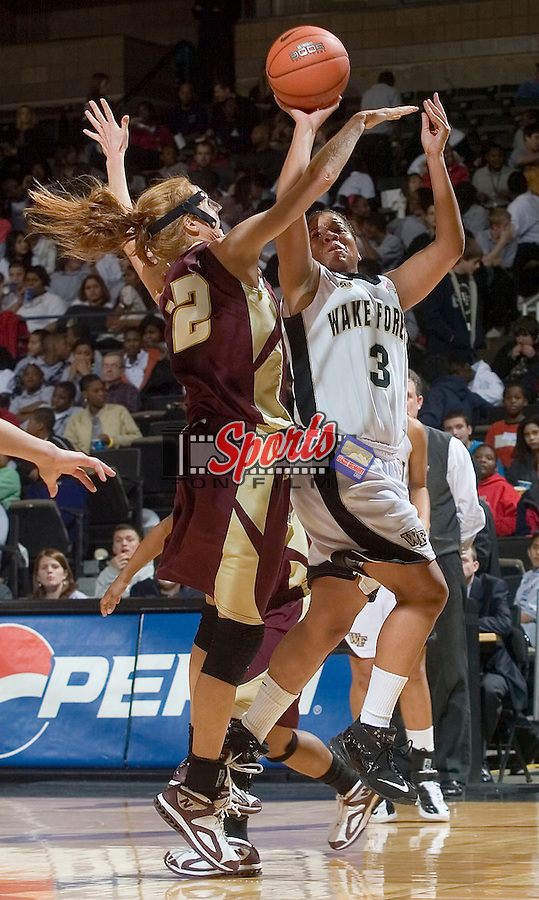 Camille Collier (3) of the Wake Forest Demon Deacons tries to hoot over Jill Furstenburg (12) of the College of Charleston Cougars at the LJVM Coliseum Wednesday, December 19, 2007 in Winston-Salem, NC.