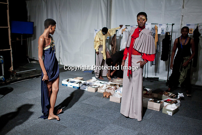 JOHANNESBURG, SOUTH AFRICA - MARCH 09: Models wait backstage before a show for the designer label David Tlale at the Joburg Fashion Week on March 09 2012, at the Hyde Park Mall in Johannesburg, South Africa. South Africa's finest designers showed their 2012 Autumn & Winter collections during the four day event. (Photo by Per-Anders Pettersson)