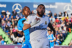 Karim Benzema of Real Madrid and Allan-Romeo Nyom of Getafe FC during La Liga match between Getafe CF and Real Madrid at Coliseum Alfonso Perez in Getafe, Spain. January 04, 2020. (ALTERPHOTOS/A. Perez Meca)