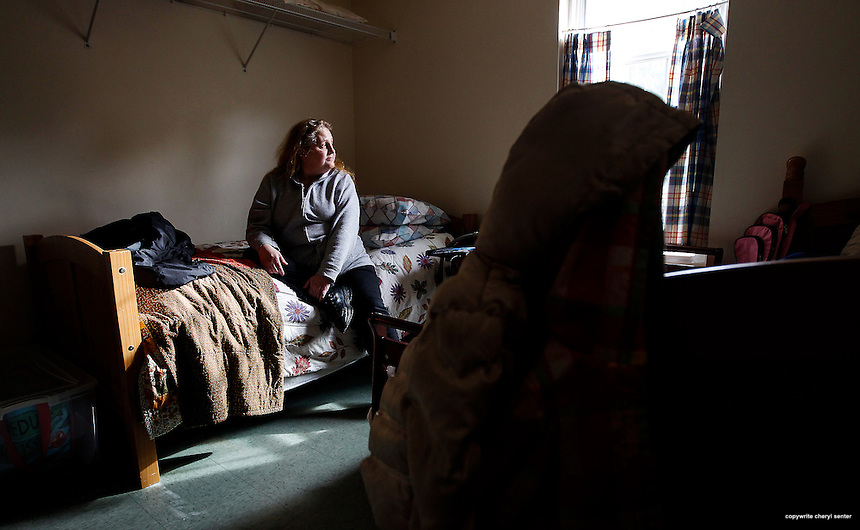 Plymouth, NH Tuesday, Nov. 25, 2014:  Lorraine Barr, 57, sits on her bed in the bedroom she shares with a child and another adult.  The number of homeless has ticked down recently, but only slightly.  Lorraine Barr, homeless, lives at a shelter at Whole Village. CREDIT: Cheryl Senter for The Boston Globe
